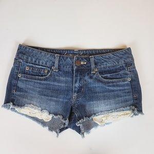 American Eagle cut off denim shorts lace sz 4